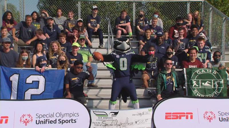The campers at Camp Shriver this year with some former stars of the Seattle Seahawks.