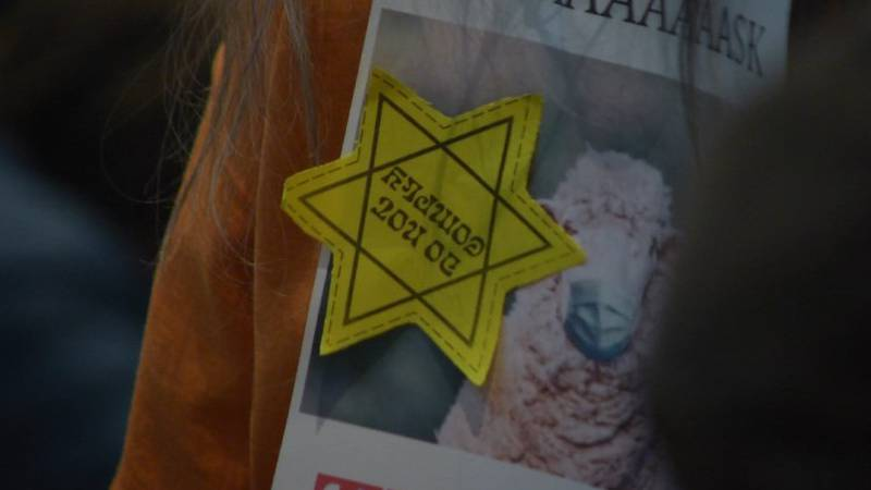 A person wears a Star of David on their clothing as they prepare to testify on a proposed...