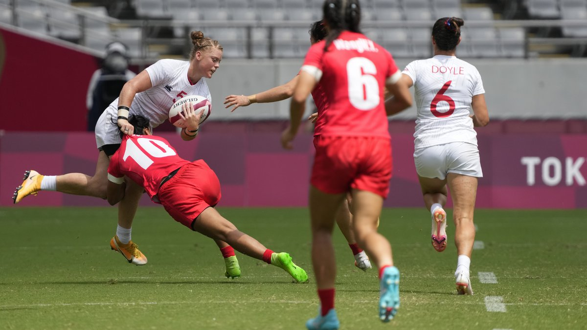 Alev Kelter of the United States gets tackled by China's Gu Yaoyao in their women's rugby...