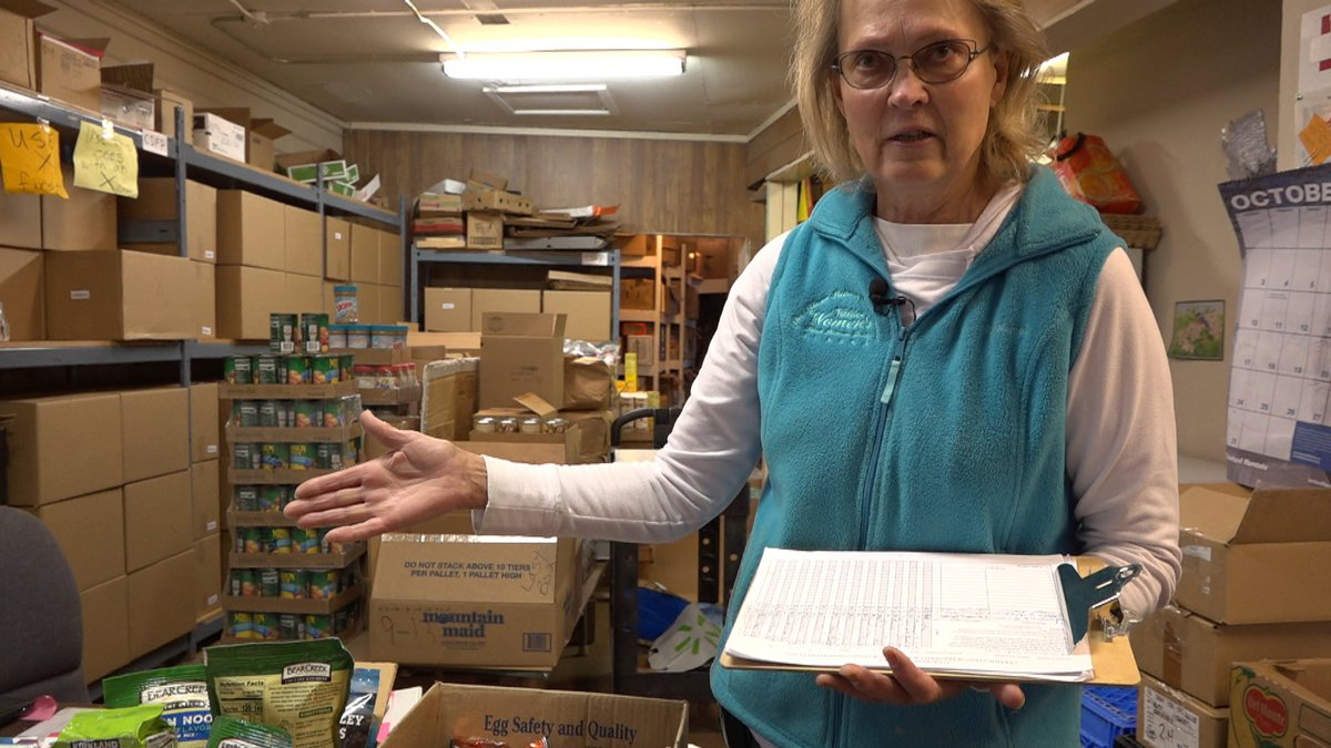 Palmer Food Bank Director Jeanne Borega shows off how crowded the facility is with food...