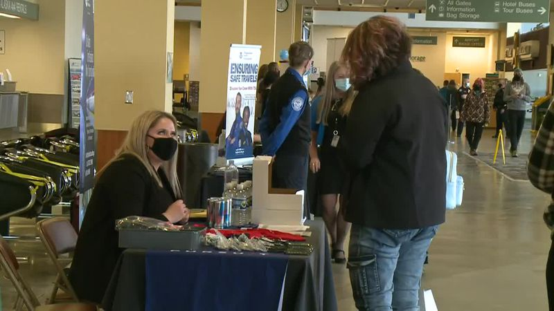 People attend Saturday's Travel and Tourism Job Fair at Ted Stevens Anchorage International...