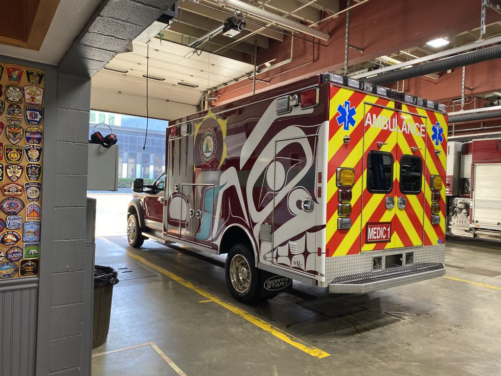The formline designs show a healing hand on both sides of the ambulance. (09/15/2020)
