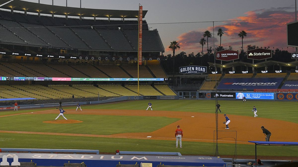 The Los Angeles Dodgers play the Los Angeles Angels at sunset during the fifth inning of a preseason baseball game, Tuesday, July 21, 2020, in Los Angeles.