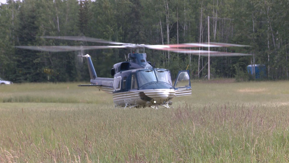 A helicopter prepares for takeoff at the Swan Lake Fire helibase. (KTUU)