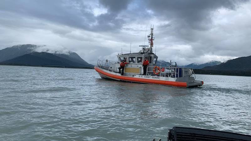 Coast Guard rescues crew from stranded boat.