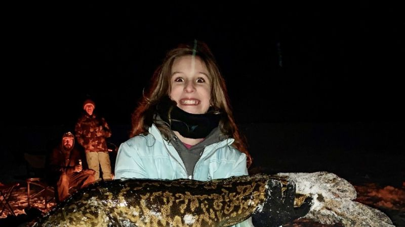 Aimee Pike holding her record-breaking Burbot.