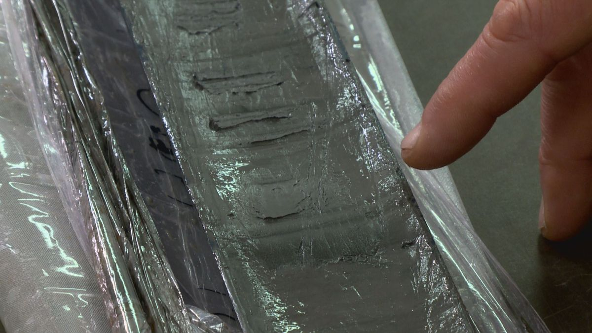 A core sample from the bottom of Eklutna Lake shows changes in sediment, occurring as a result of the 1964 earthquake.