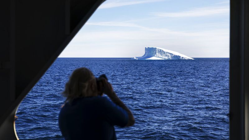 FILE - In this July 27, 2017, file photo, an iceberg floats past the Finnish icebreaker MSV...