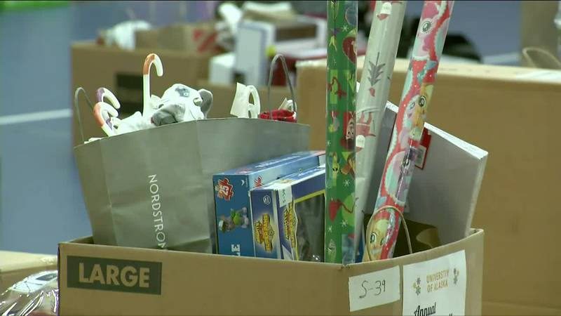 Presents fill a gymnasium at the Salvation Army for its Adopt-a-Family holiday program