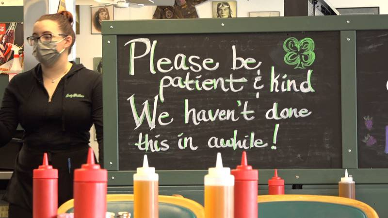 A sign at Lucky Wishbone reminding customers that in house service is a little rusty after over...