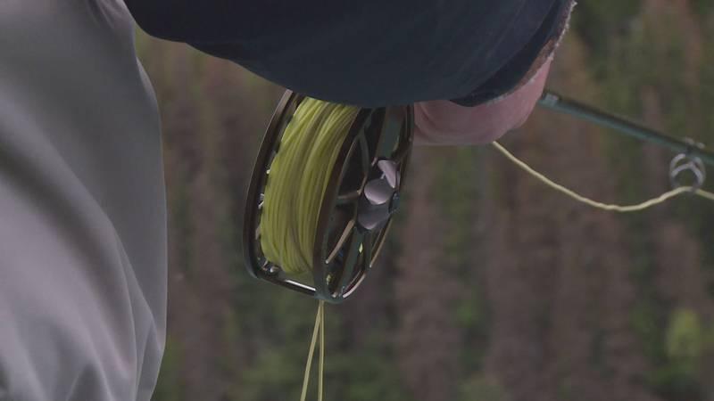 Fly fishing on the upper Kenai River in Alaska.