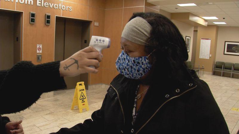 Janice Jackson is screened before visiting her daughter at Alaska Regional Hospital