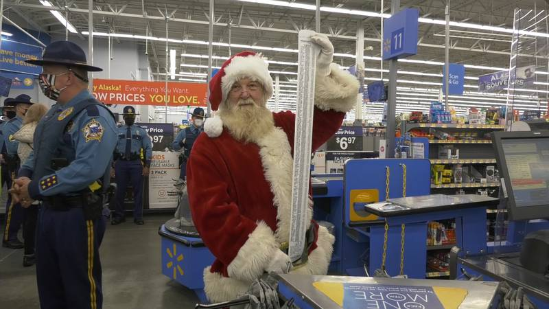 Santa Claus is seen with Alaska State Troopers at the Fairbanks Wal-Mart as they bought over...