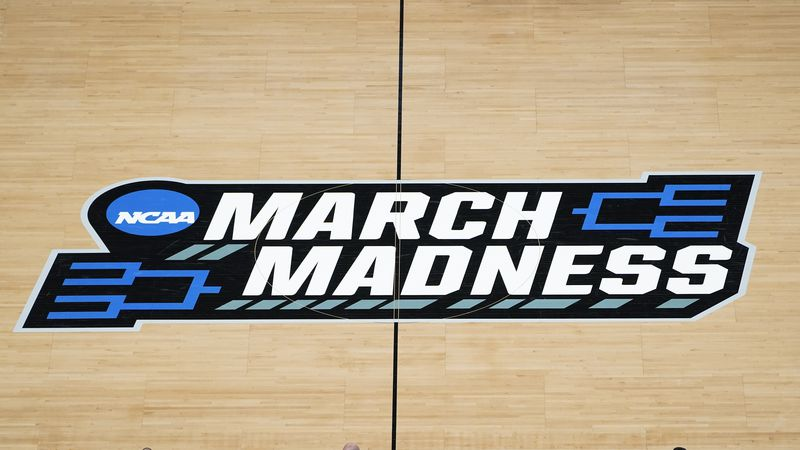 In this March 20, 2021, file photo, the March Madness logo is shown on the court during the...