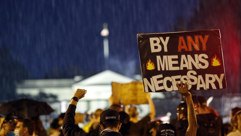 Demonstrators protest Thursday, June 4, 2020, near the White House in Washington, over the...