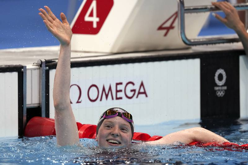 Lydia Jacoby of the United States waves after winning the final of the women's 100-meter...