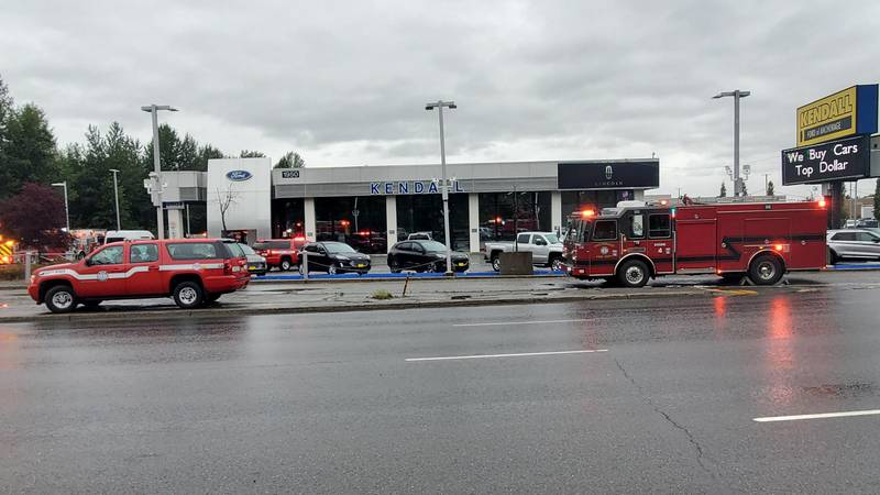 Anchorage Fire Department vehicles surround the Kendall Ford building on Seward Highway as...