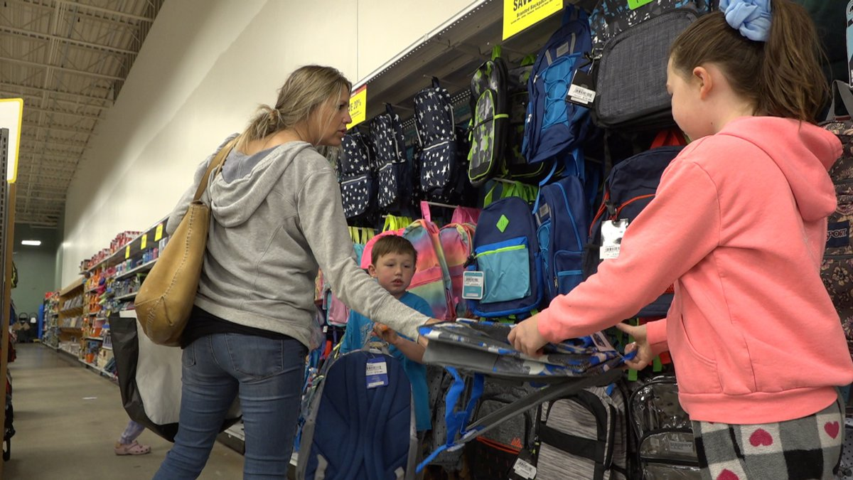 Anchorage mom, Chelsea Pohland picking out backpacks and other Back to School supplies for her...