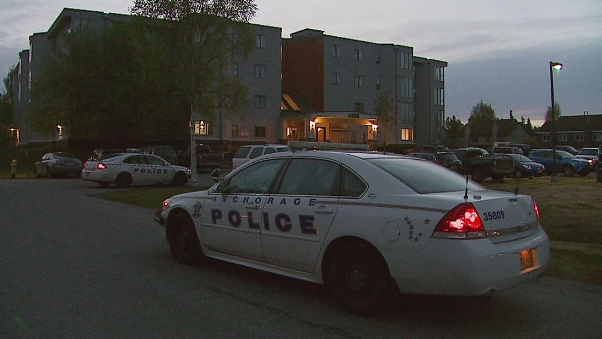 Police outside of an Anchorage apartment building, scene of a reported double shooting. Photo...