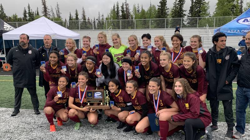 The Dimond High School girls soccer team celebrates after winning the ASAA 2021 state...