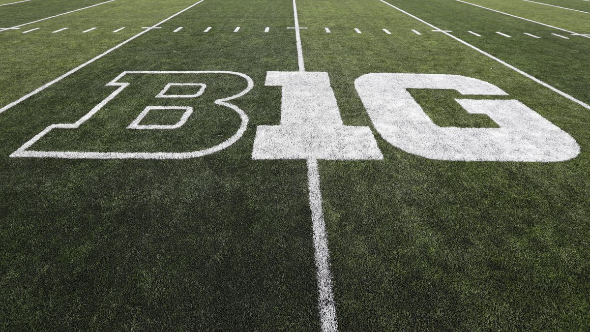 The Big Ten logo is seen on the field before an NCAA college football game between Iowa and Miami of Ohio, Saturday, Aug. 31, 2019, in Iowa City, Iowa. The Big Ten released its 10-game conference-only football schedule beginning as early as Labor Day weekend but cautioned there is no certainty games will be played.