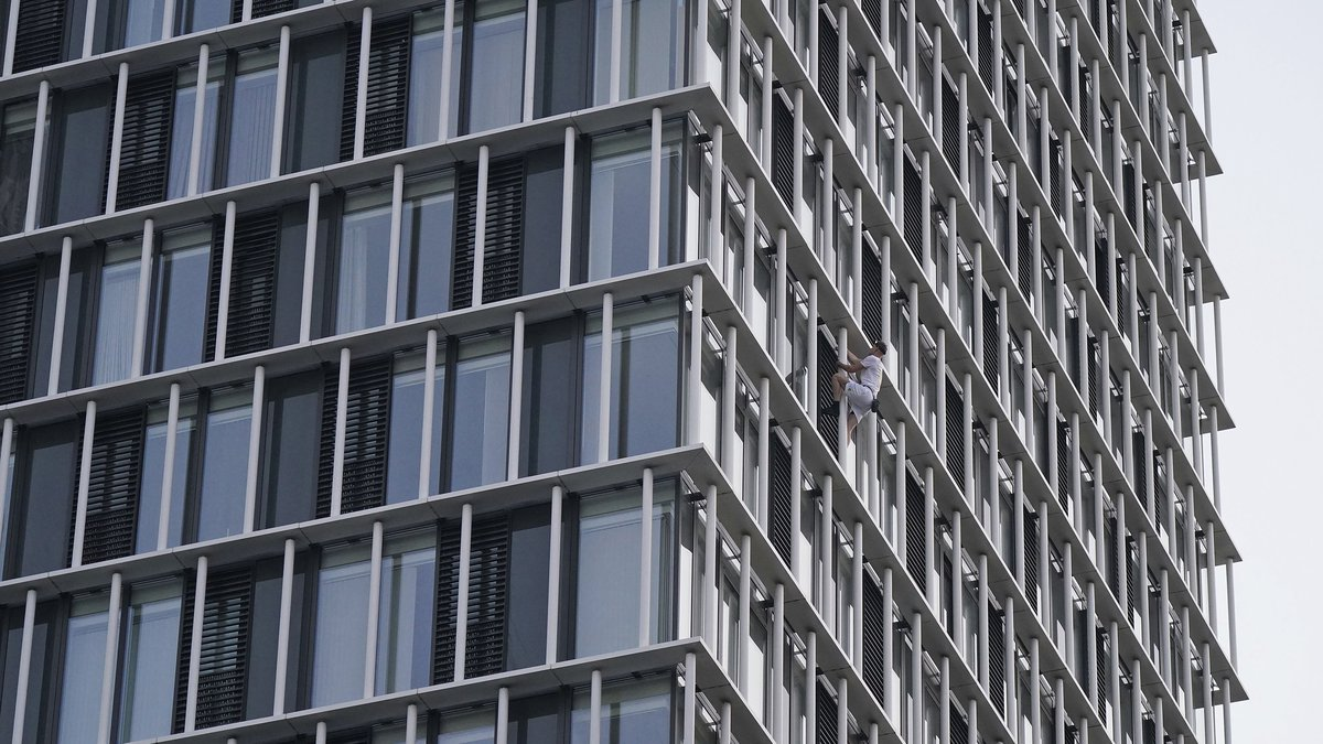 Free climber George King-Thompson climbs the Stratosphere Tower building, a 36-story...