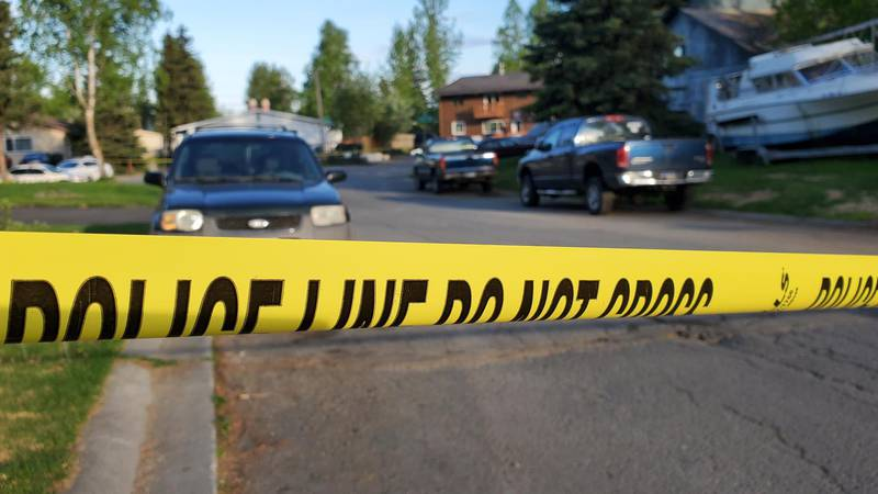 Police tape blocks off a section of Valley Street as Anchorage police investigate a shooting in...