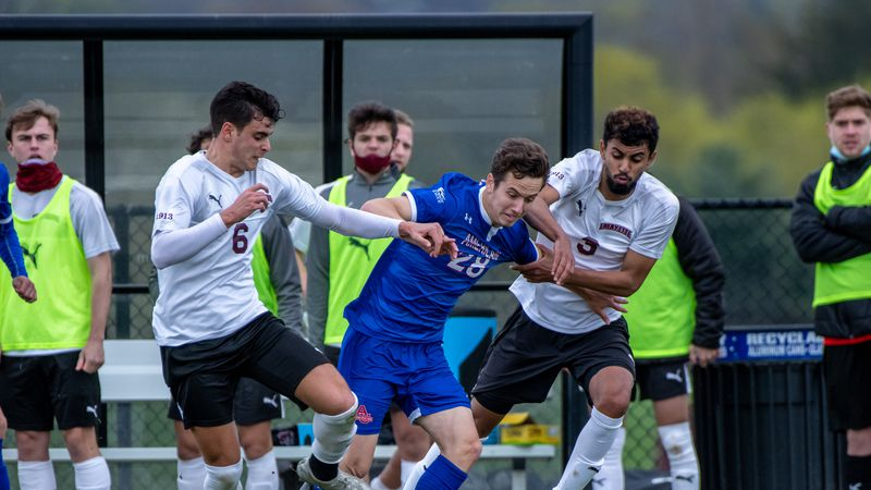 Jack Green playing soccer for American University.