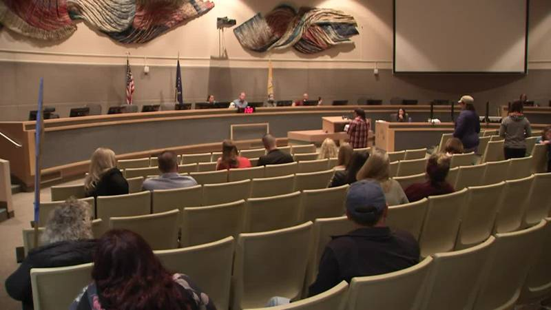 Opponents of COVID-19 vaccine mandates gather at listening session inside the Anchorage...