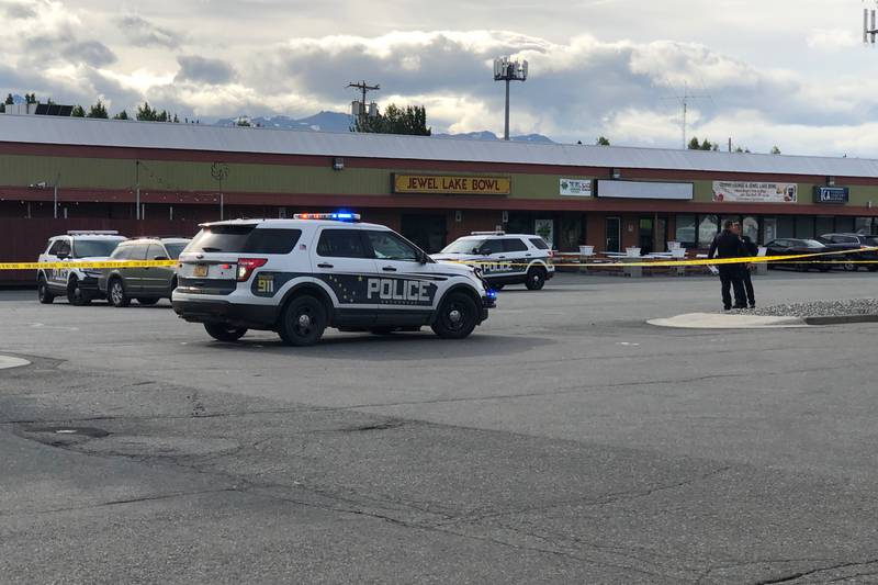 Anchorage police closed off the Jewel Lake Bowl parking lot in Sand Lake on Wednesday for their...