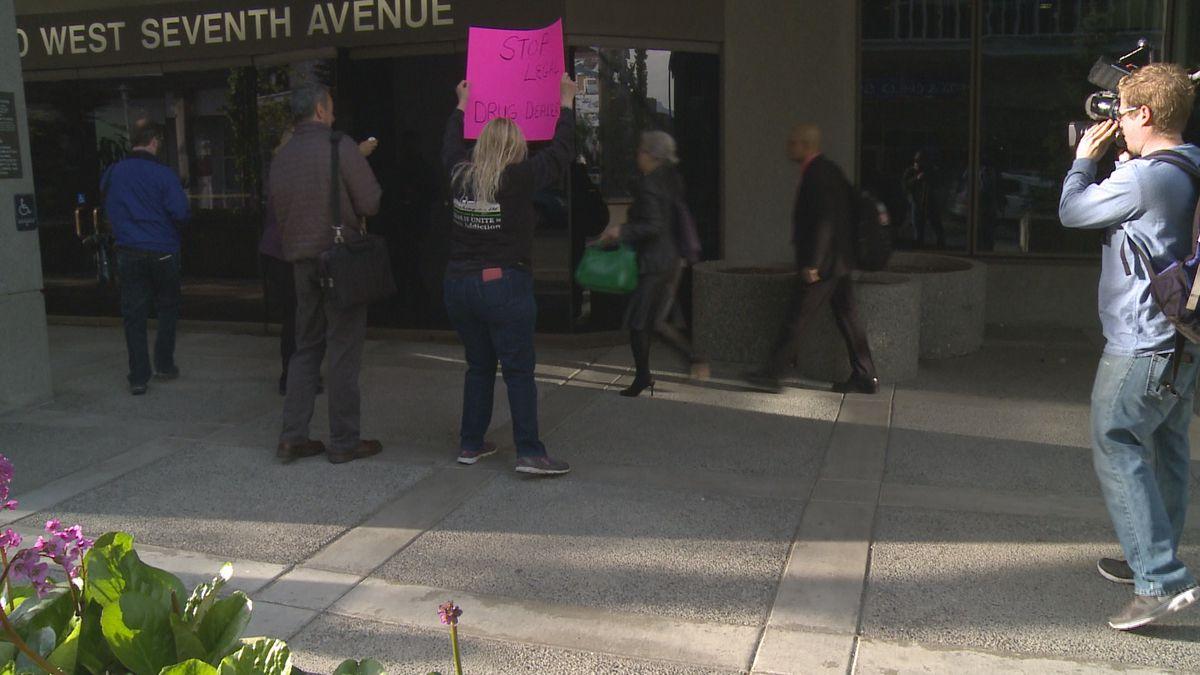 Demonstrators protest against Mahmood Ahmad's efforts to regain his medical license in Alaska