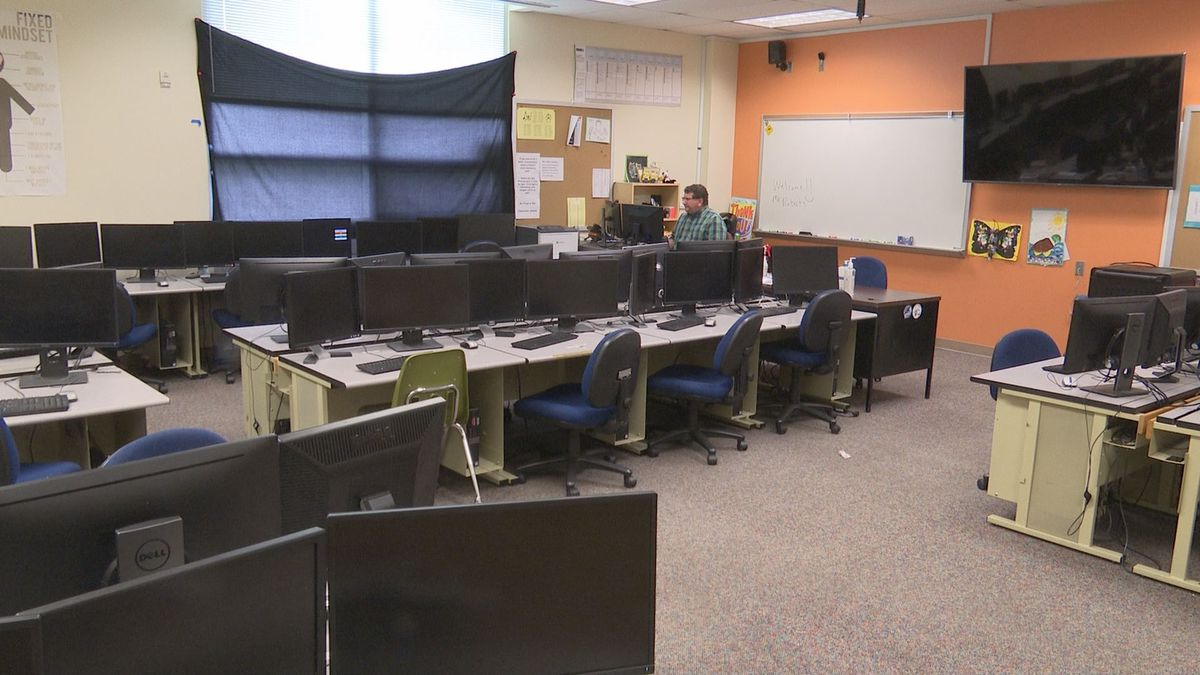 Devon Roberts teaches his virtual lesson in an empty classroom at Service High School.