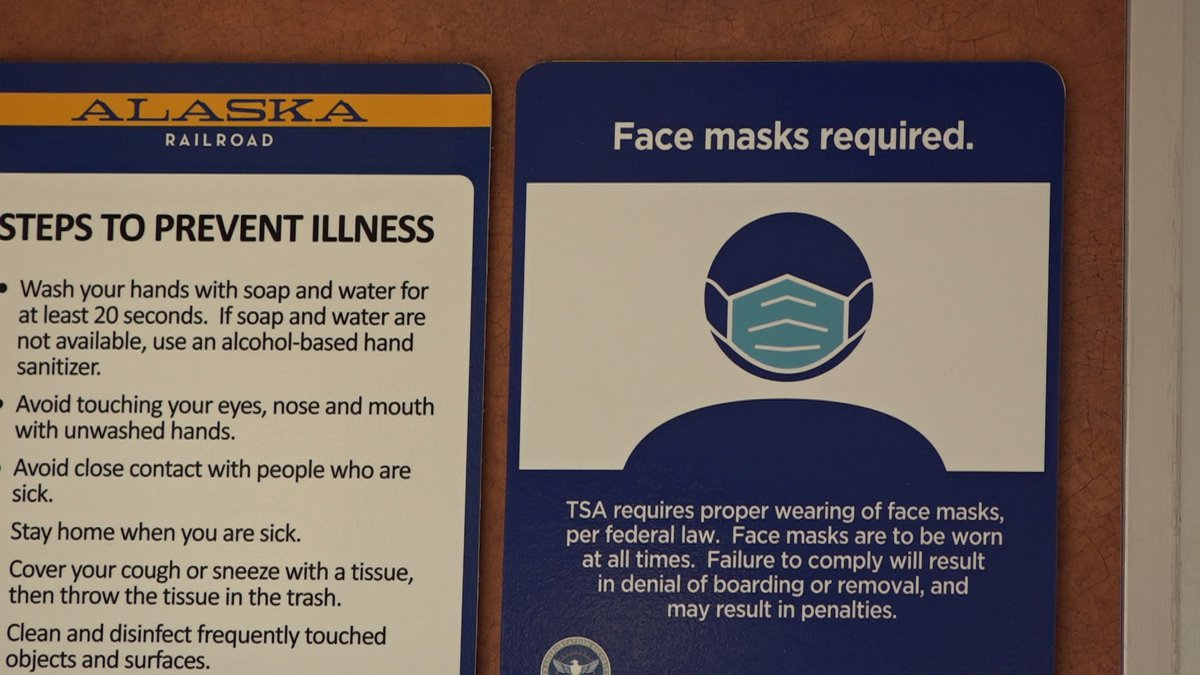 Some signage reminding Alaska Railroad customers that they need to wear masks while onboard and...