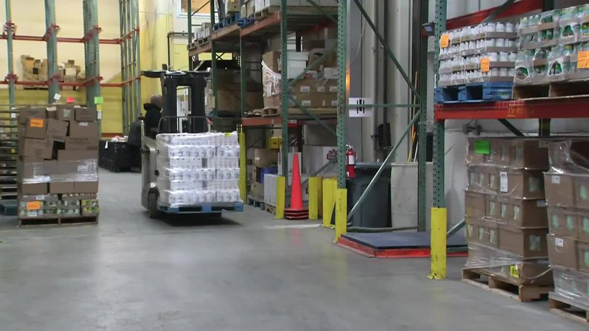 Workers unload major donation of food from ConocoPhillips