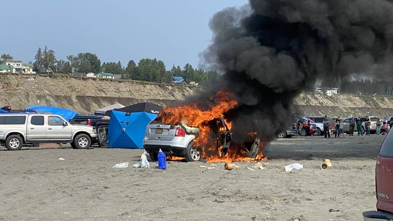 An SUV is engulfed in flames at South Beach in Kenai on Saturday afternoon.