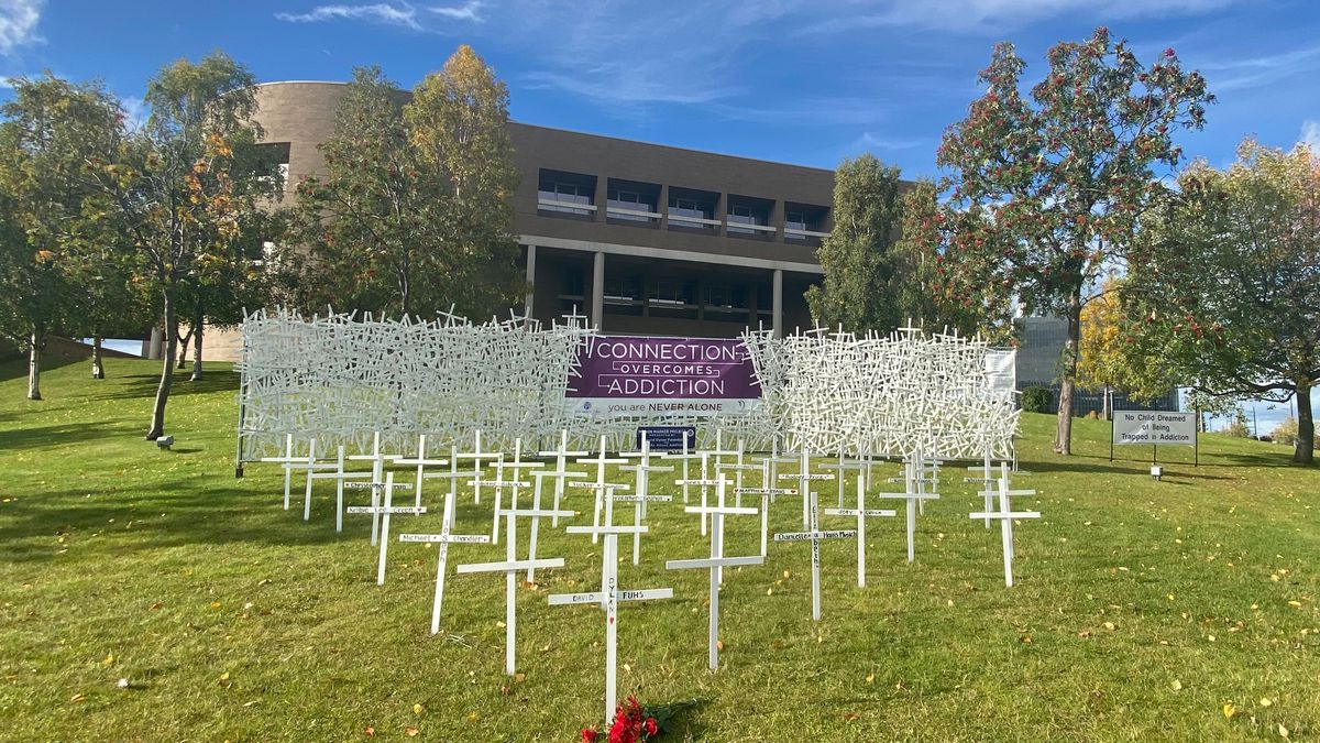 A display of 1,000 crosses stands as a memorial for Alaskans lost to addiction and substance misuse outside the Loussac Library on Sept. 18, 2020.