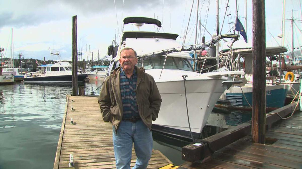 "Charles ""Chuck"" Hanas in front of his boat. He was the first person to arrive at the scene of Monday's two plane collision."