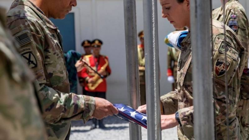 Alaska Army National Guard Capt. Jessica Miller and Sgt. 1st Class Juan Restrepo spend time...