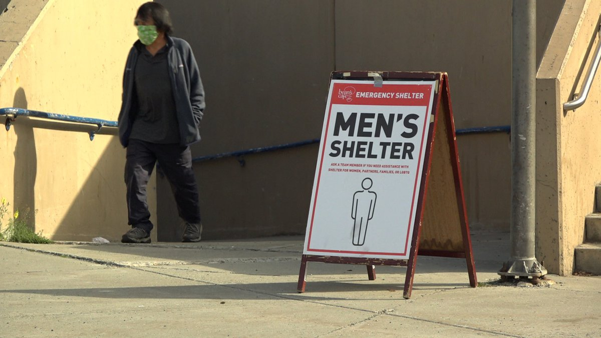 A man walks out of the men's section of the mass shelter at the Sullivan Arena in Anchorage.