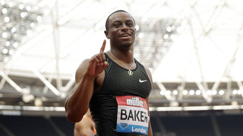Ronnie Baker of the U.S. celebrates after winning the men's 100 meters race final at the IAAF...