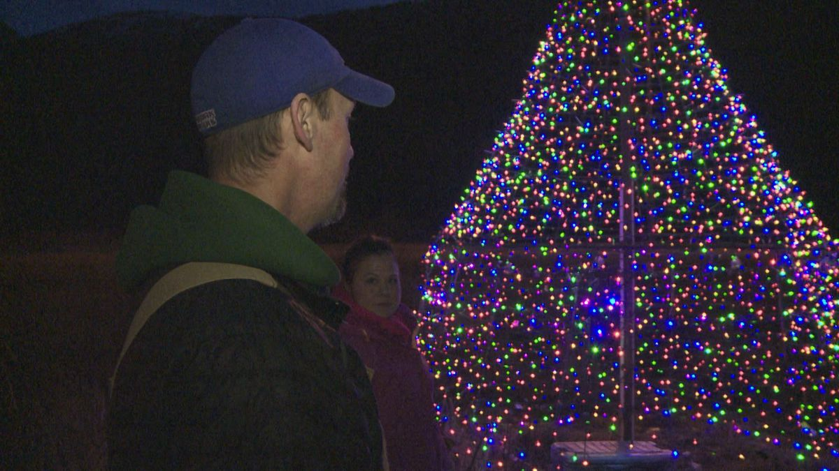 Jason and Kaye Tolstrup spend Thanksgiving evening lighting up the Glenn Highway Christmas tree. (KTUU)