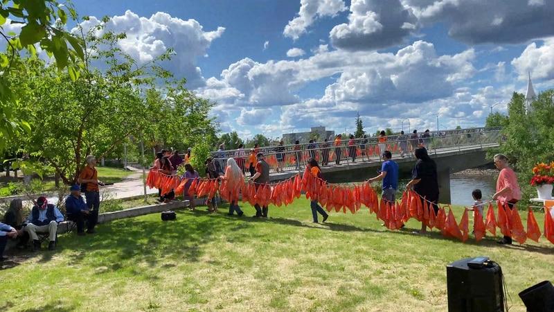 Alaska Native community members held a vigil to honor the memory of both the 215 indigenous...