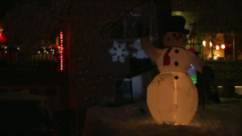 The home is lit up with a smiling snowman, dancing snowflakes and and a whole lot of other...