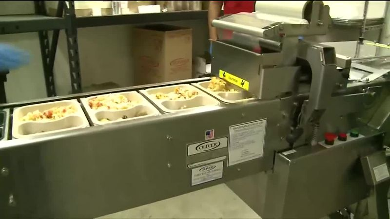 Machine helps Bean's Cafe package and seal around 2300 meals per day.