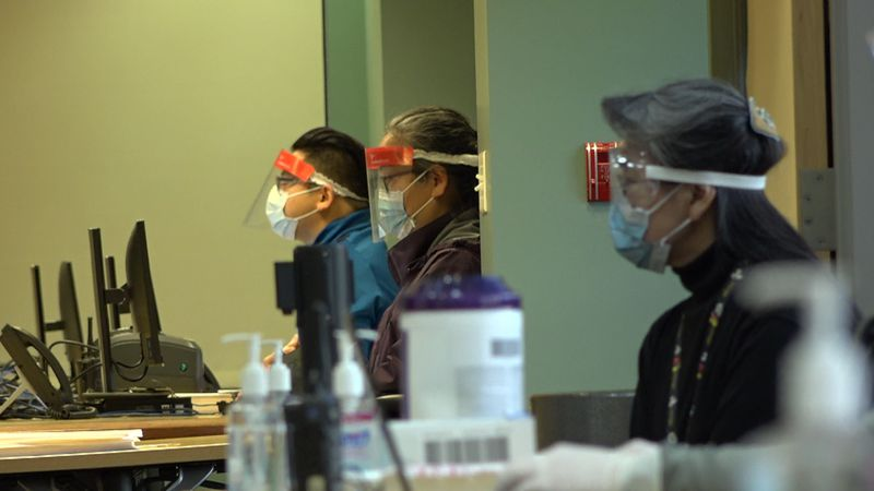 Alaska Native Medical Center workers lined up and ready to conduct COVID-19 tests at a...
