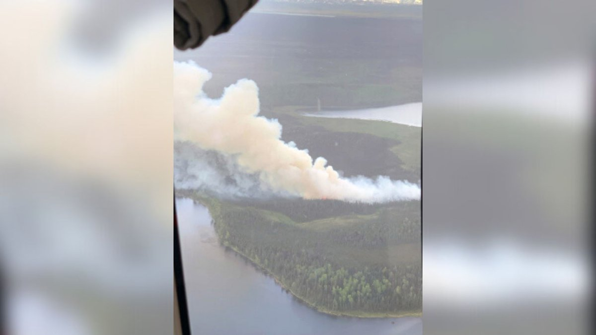 A photo taken by a pilot above the Loon Lake Fire burning about one-half mile southwest of Swan...