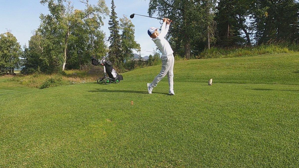 Golfer Zeyu Zhao teeing off at Anchorage Golf Course.