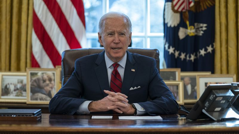 President Joe Biden delivers remarks on health care, in the Oval Office of the White House,...