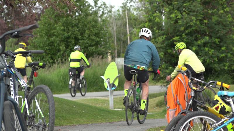 A group of cyclists off for a ride at Margaret Eagan Sullivan Park.