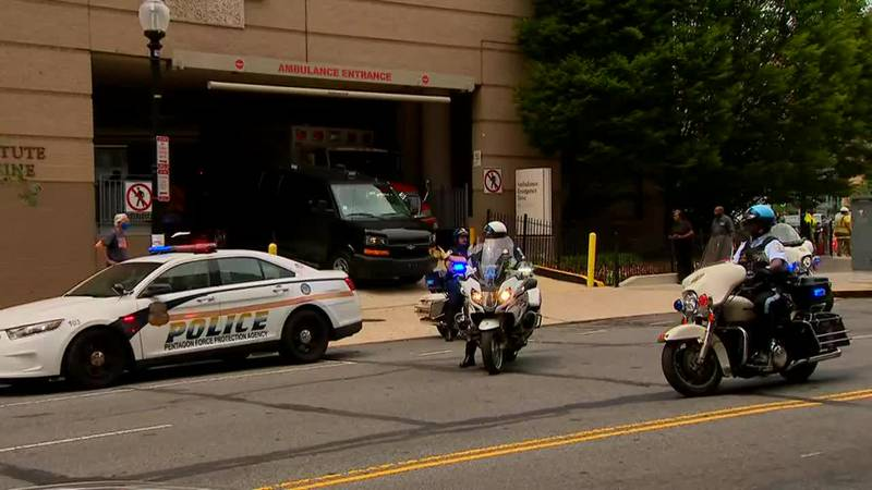Police lead a procession from George Washington University Hospital in Washington, D.C. after...